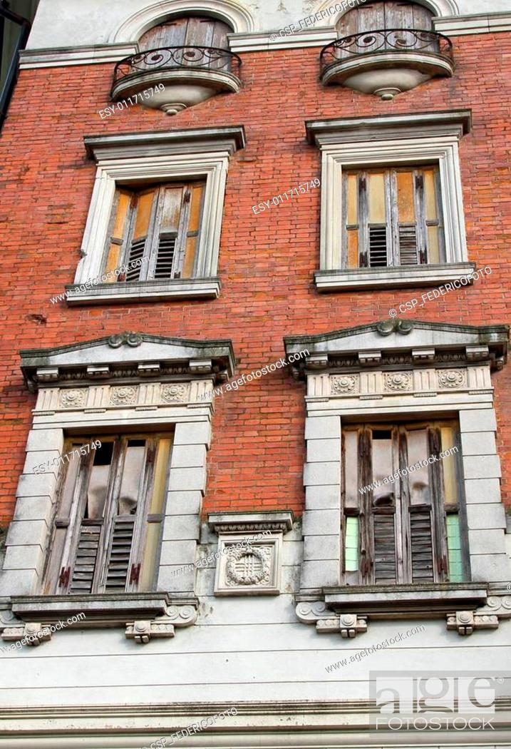 Stock Photo: old building with balconies and wooden fixtures completely ruine.