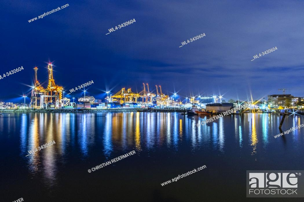 Stock Photo: Industrial Harbour lid with lots of lights after sunset.