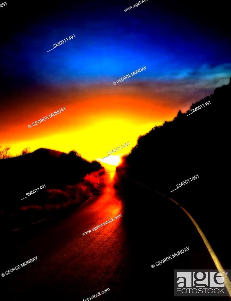 Stock Photo: Sunset on a mountain road.