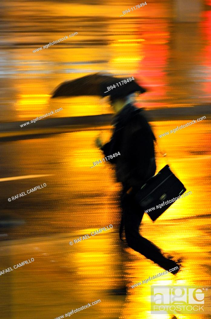 Stock Photo: People with umbrella in a rainy day, Barcelona, Catalonia, Spain.