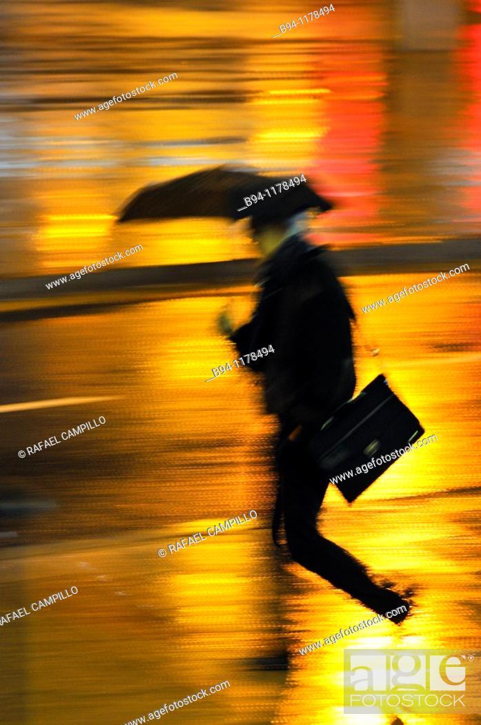 Stock Photo: People with umbrella in a rainy day, Barcelona, Catalonia, Spain.
