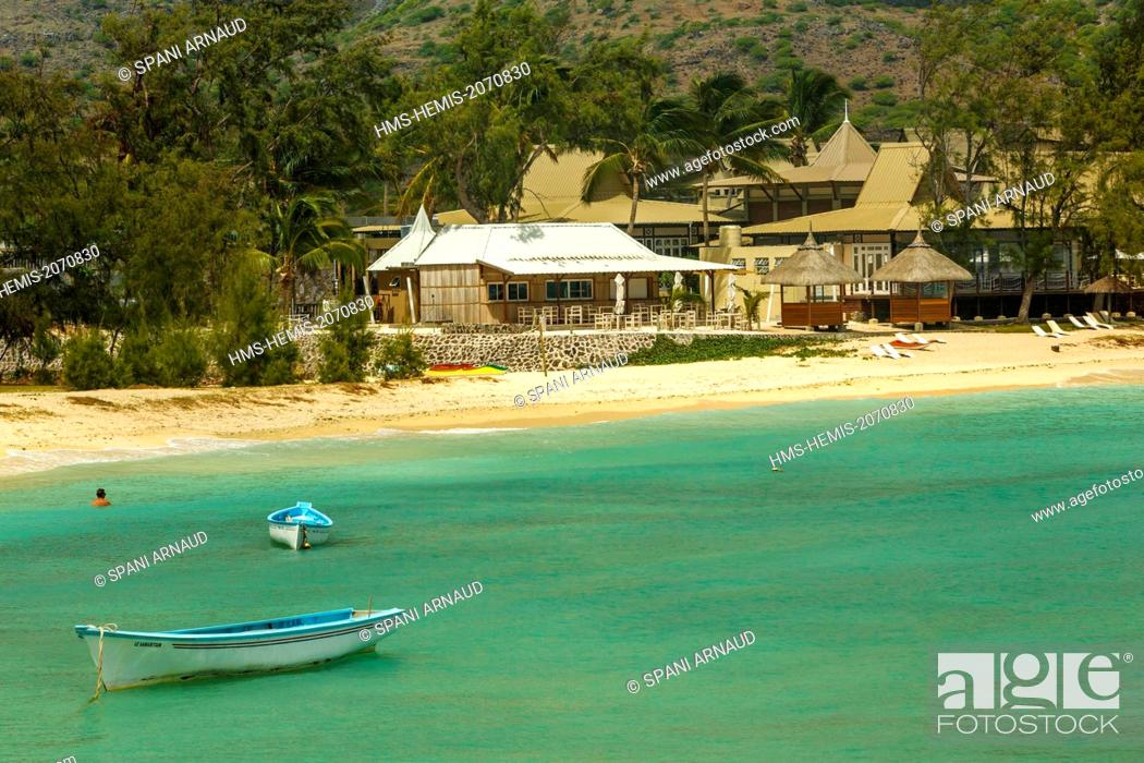 Stock Photo: Mauritius, Rodrigues Island, Pointe Coton, horizontal view of a luxury beachfront hotel and fishing boats in a cove of a blue lagoon.