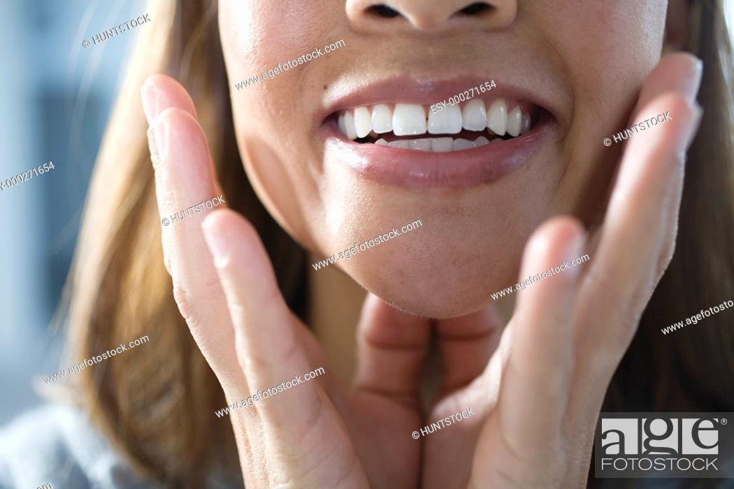 Stock Photo: Close up of a business woman smiling.