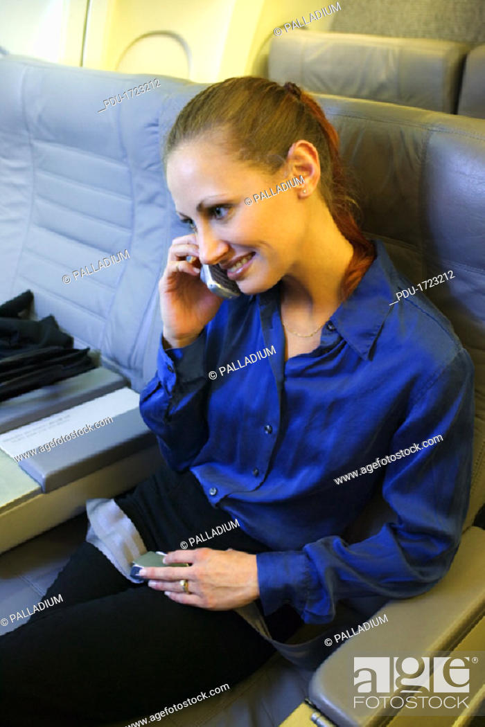 Stock Photo: View of a woman inside of an airplane.