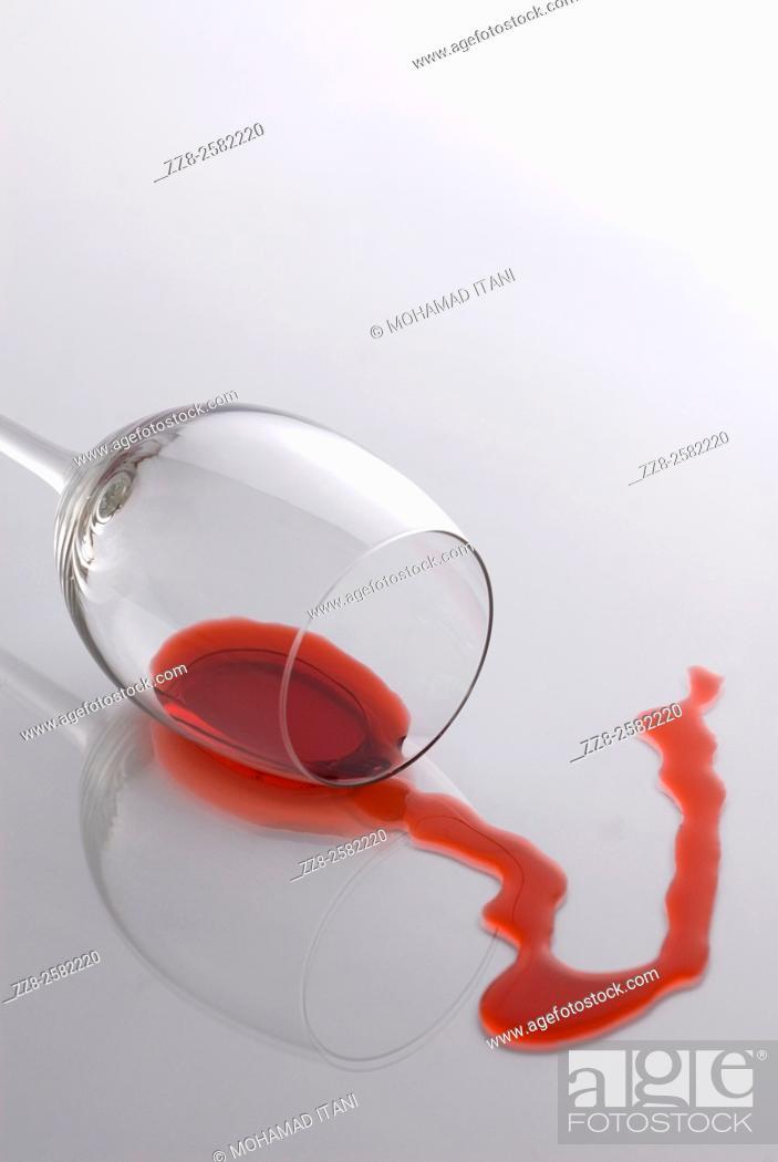 Stock Photo: fallen glass wine spilling.