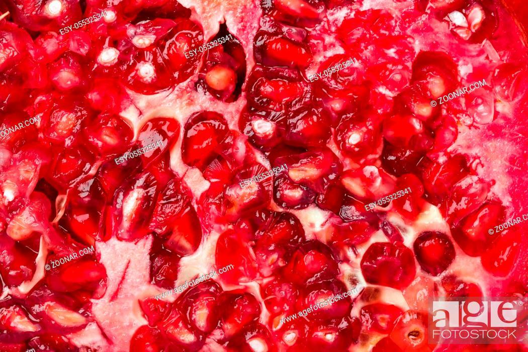 Stock Photo: Macro of ripe pomegranate - food background.