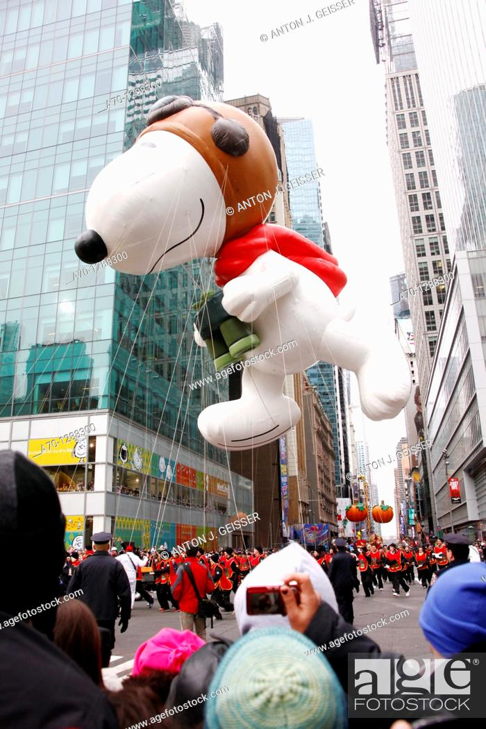 Stock Photo: New York City, snoopy balloon at the 85th Macys Thanksgiving Parade.