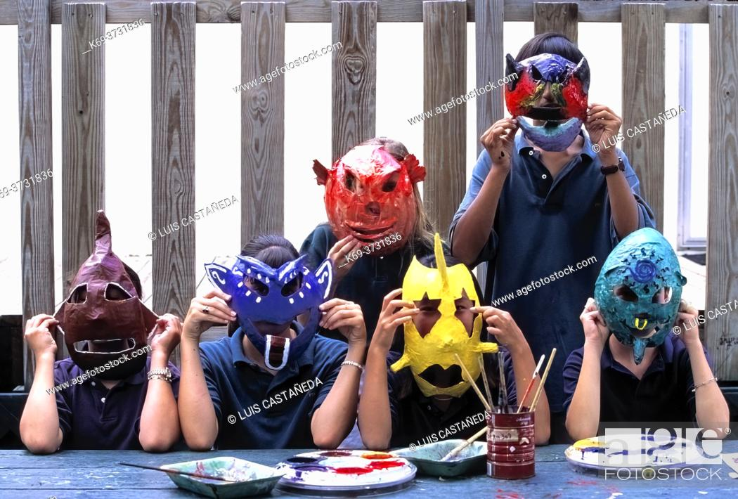 Stock Photo: Art students wearing masks. . Art School. . Miami. Florida. USA.