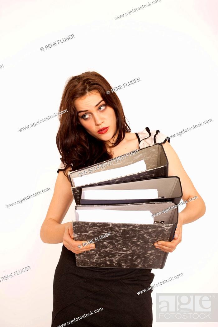 Imagen: A beautiful young woman, lady, girl, secretary, personal assistant, office work, job, employee, worker, paper work, folders CTK Photo/Rene Fluger MODEL RELEASED.