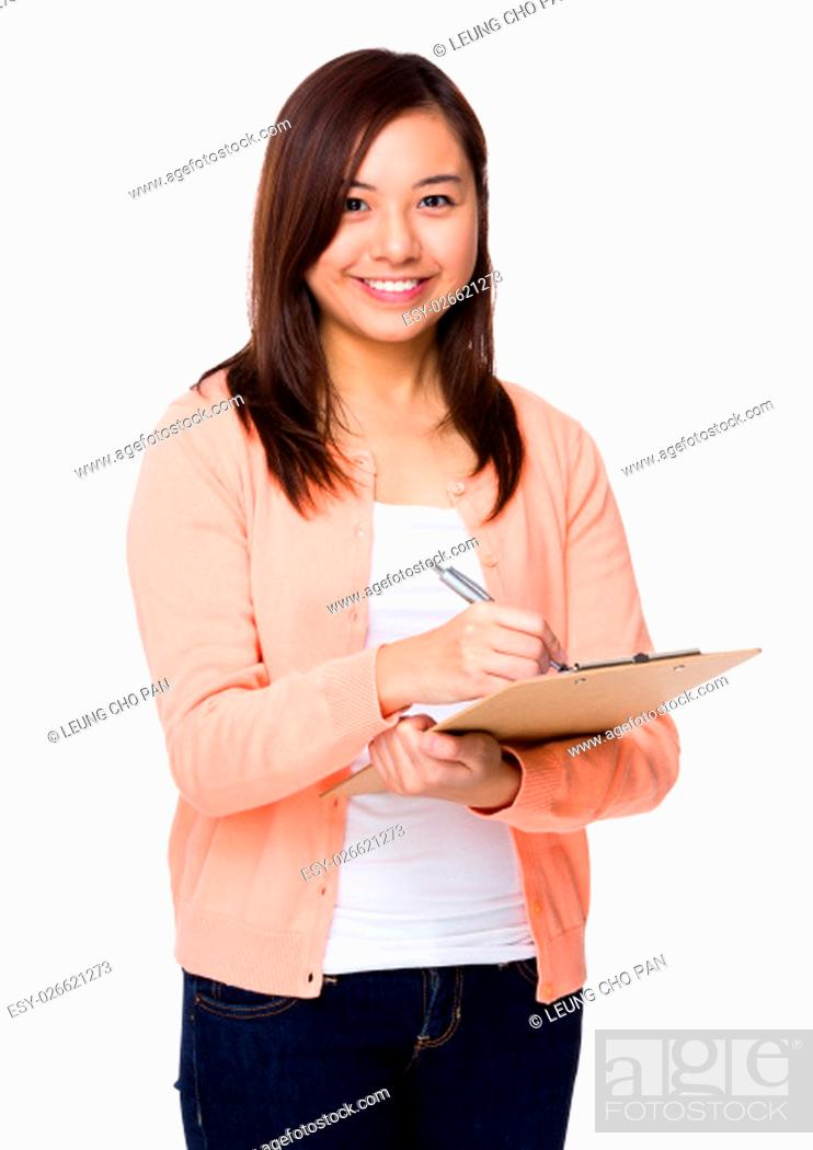 Stock Photo: Young woman write on clipboard.