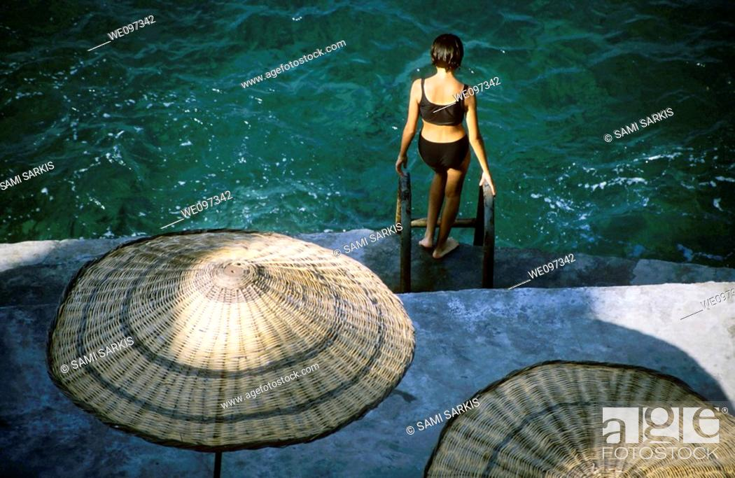 Stock Photo: Young woman going swimming in the sea, Izmir, Turkey.