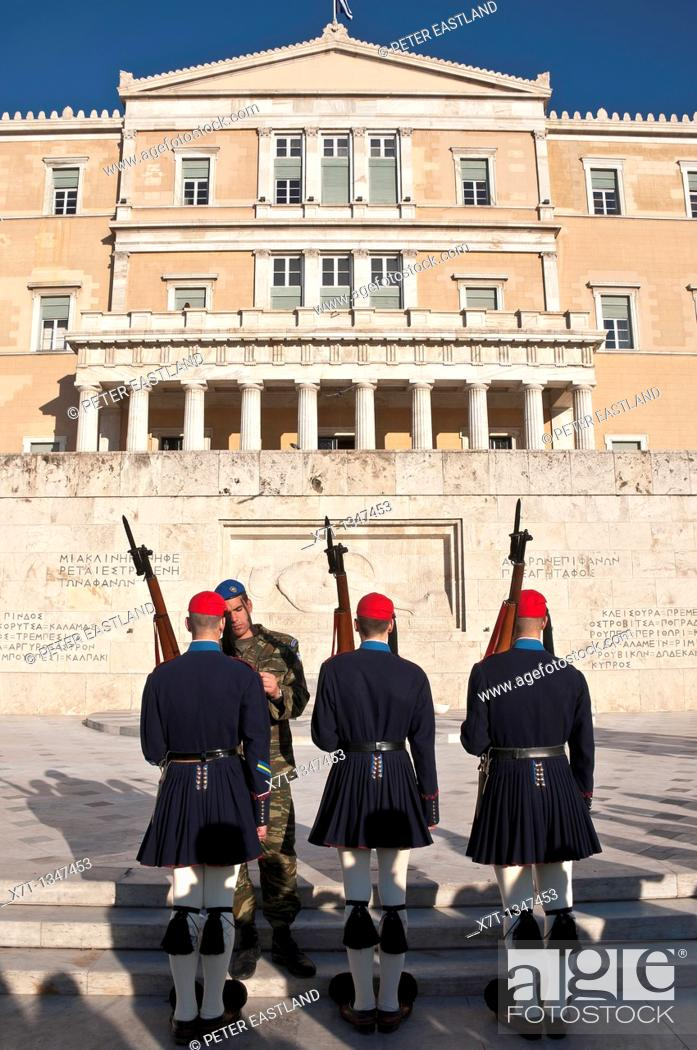 Stock Photo: Evzones, an elite core of Greek soldiers used to guard the tomb of the unknown soldier infront of the Hellenic Parliament building in Syndagma Square in the.