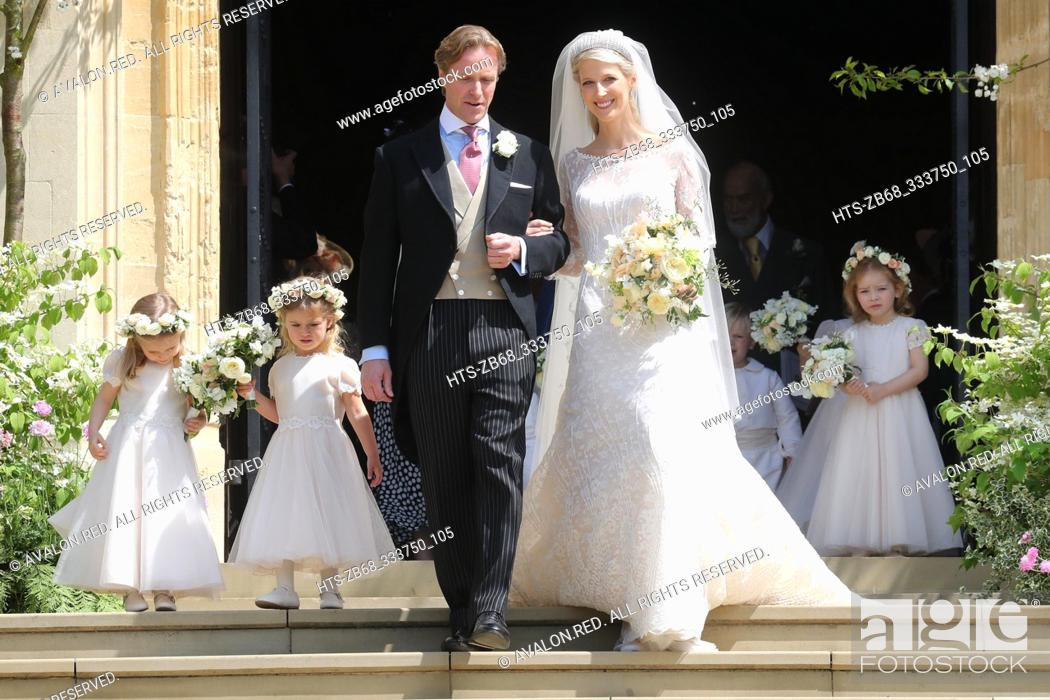 Stock Photo: Newlyweds Mr Thomas Kingston and Lady Gabriella Windsor walk down the steps of the chapel with their bridesmaids after their wedding at St George's Chapel on.