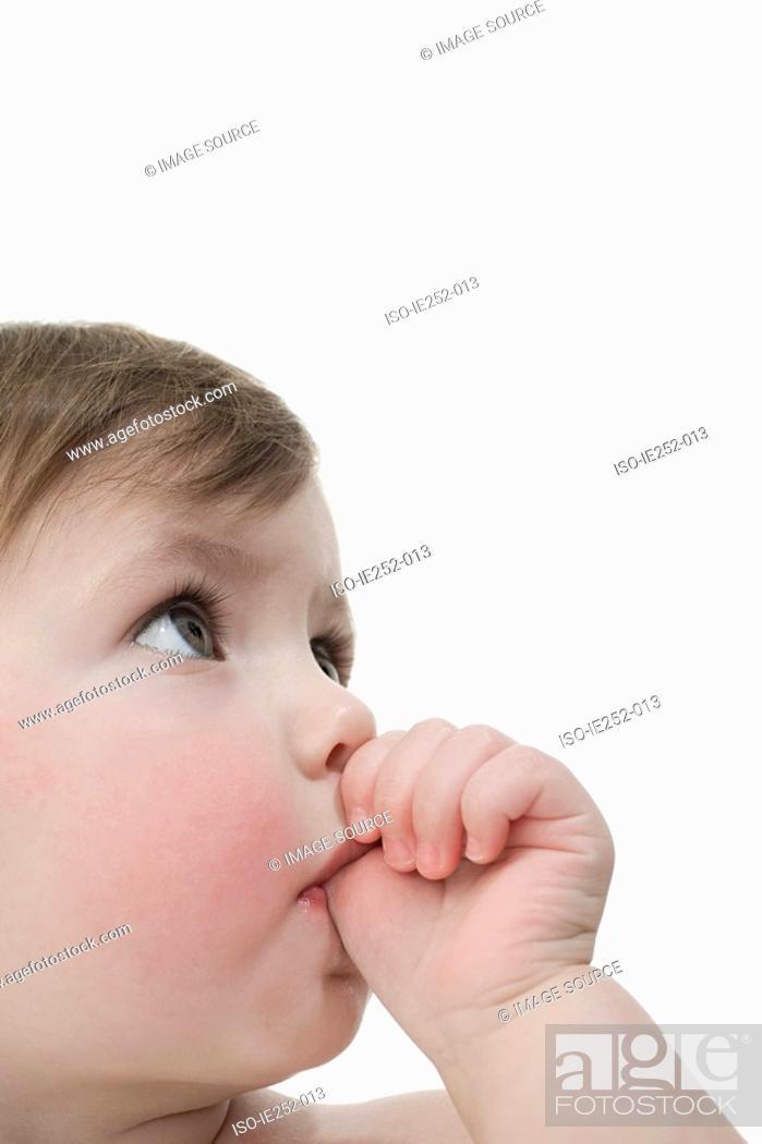 Stock Photo: Baby girl sucking her thumb.