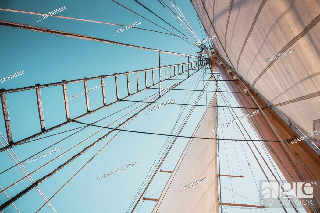 Stock Photo: Looking up view of rigging and sails on an antique sailing ship.