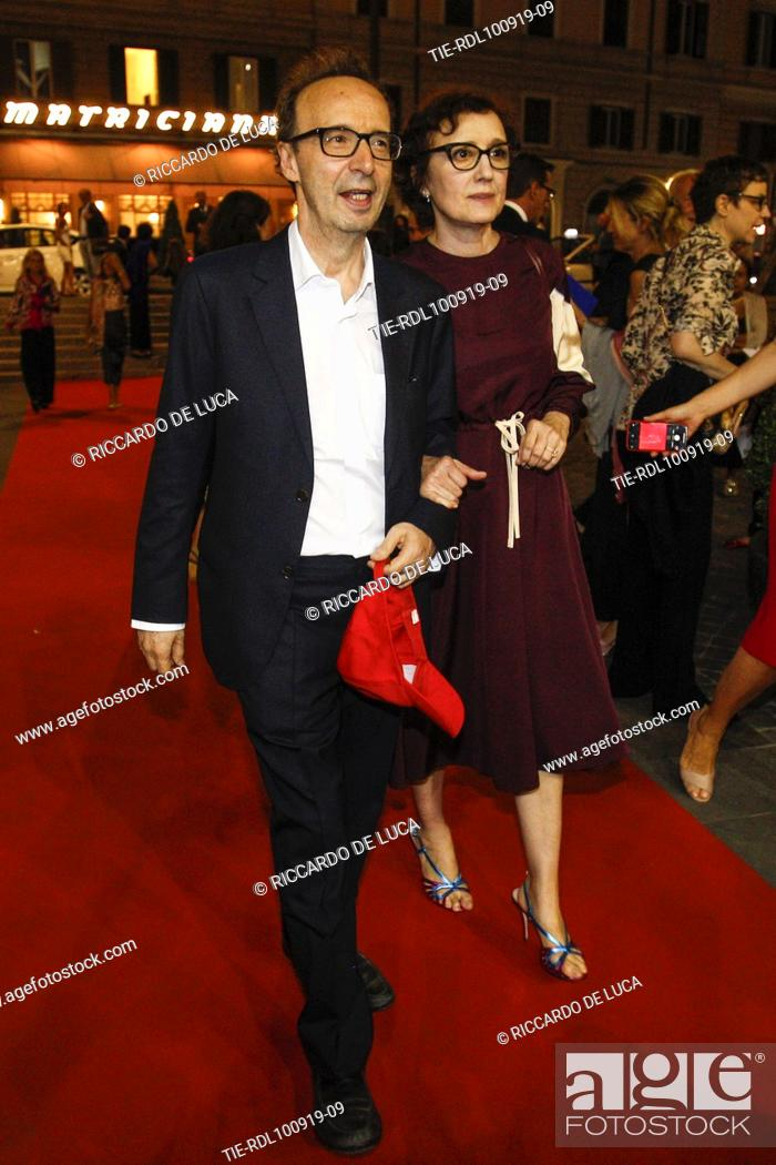 Stock Photo: Roberto Benigni and wife Nicoletta Braschi arrive at the Premiere of theatrical performance ' Waiting for the Sibyl ' at Opera Theatre of Rome, ITALY-10-09-2019.