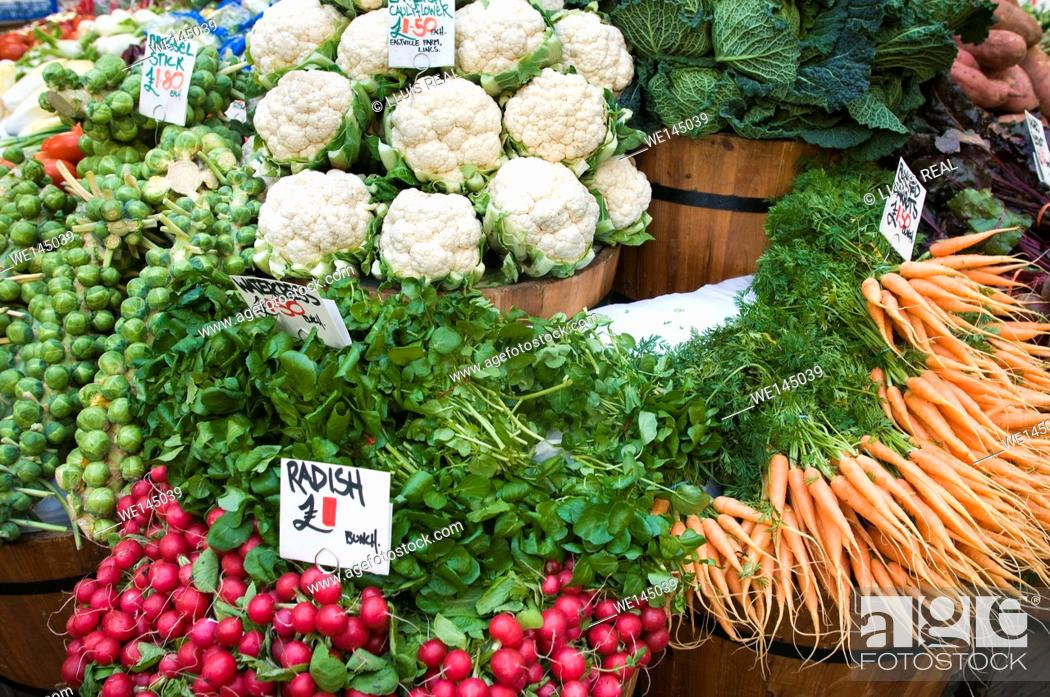 Stock Photo: market store with fresh vegetables, cauliflower, Brussels sprouts, radish, carrots. Borought Market, Southwark, London, England, UK, Europe.