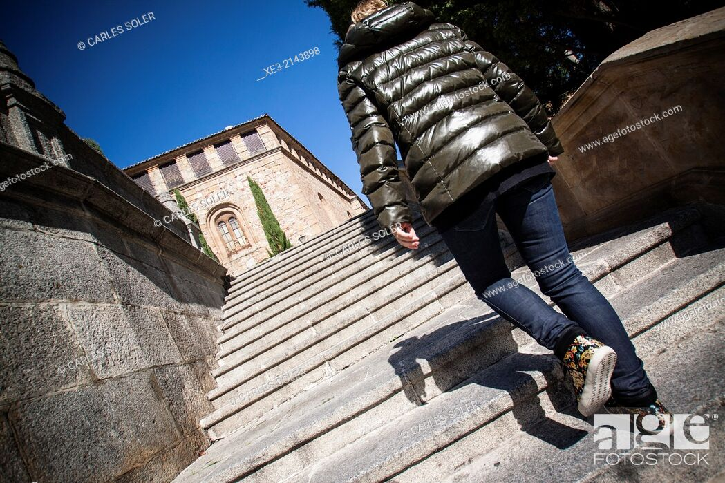 Stock Photo: Young girl climbing stairs. Old City. Salamanca, Castile-Leon, Spain.