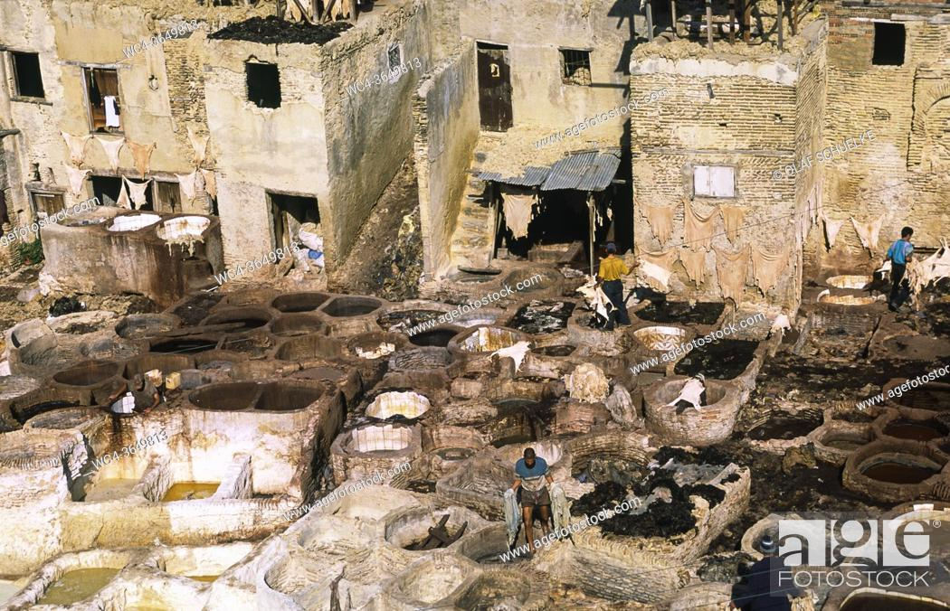 Stock Photo: Fes, Morocco, Africa - Elevated view of a traditional tannery and dye factory in the walled medina with its historic buildings of the old city.