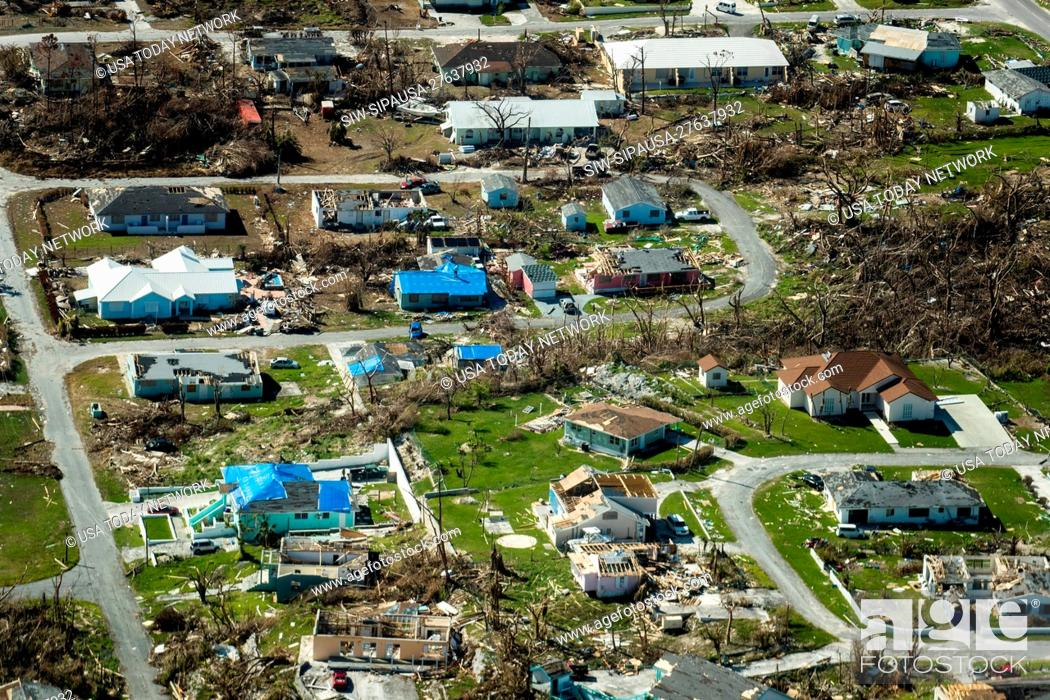 Stock Photo: Blue roofs are starting to show up on houses damaged by Hurricane Dorian in the Bahamas. These are on homes in Marsh Harbour on Tuesday, September 24, 2019.