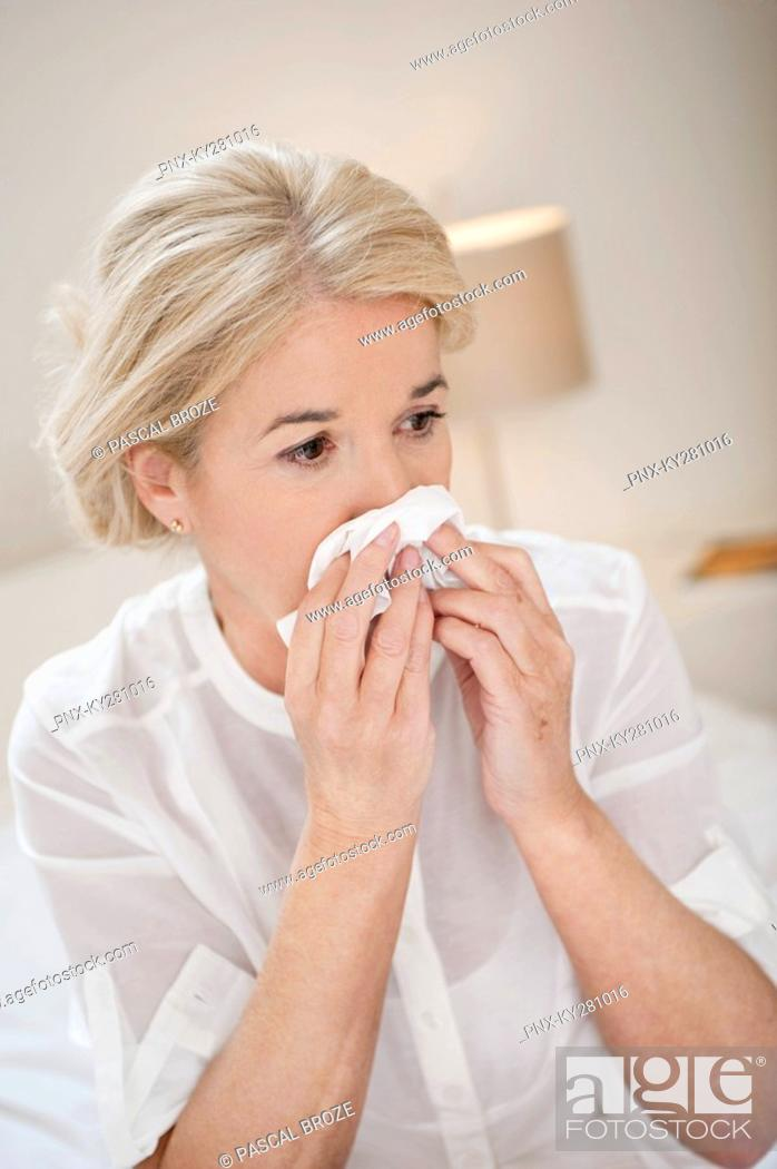 Stock Photo: Close-up of a woman suffering from cold.