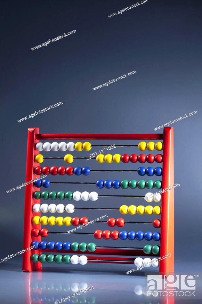 Stock Photo: An abacus with multi colored wooden beads.