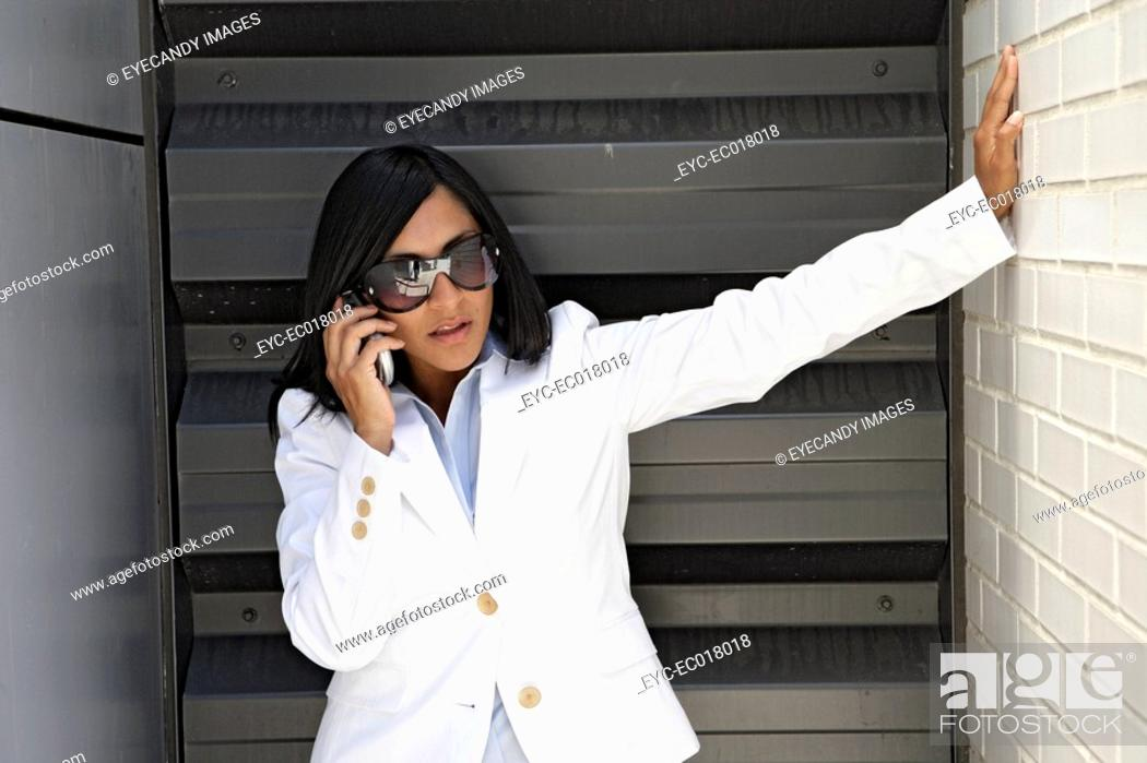 Stock Photo: Portrait of a young woman using a cellphone.