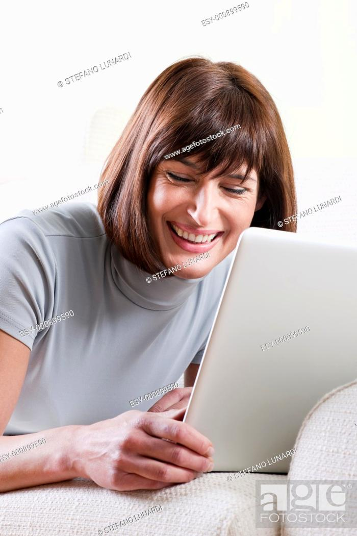 Stock Photo: Woman using laptop at home.