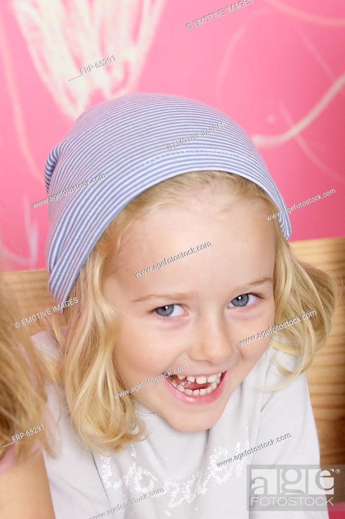 Stock Photo: Blond girl wearing a headscarf.