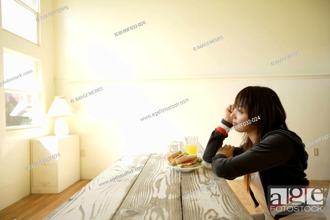 Stock Photo: View of a contemplative woman.