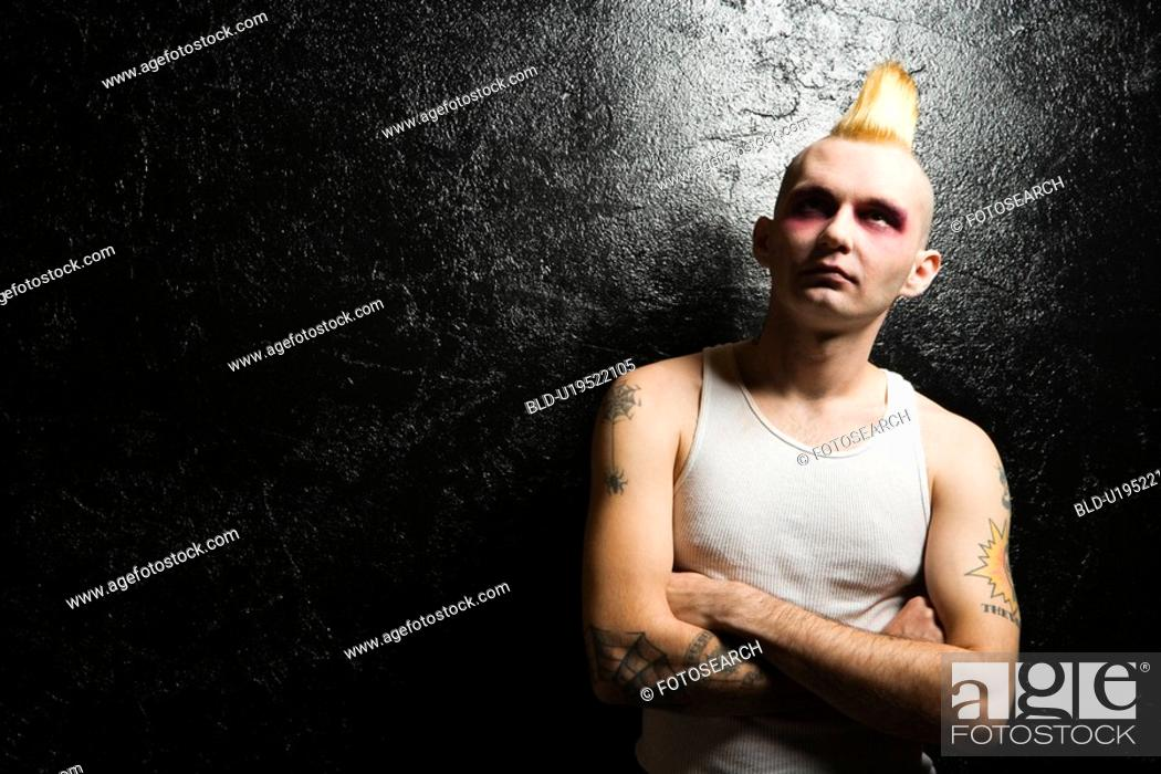 Stock Photo: Portrait of male punk rocker with crossed arms.