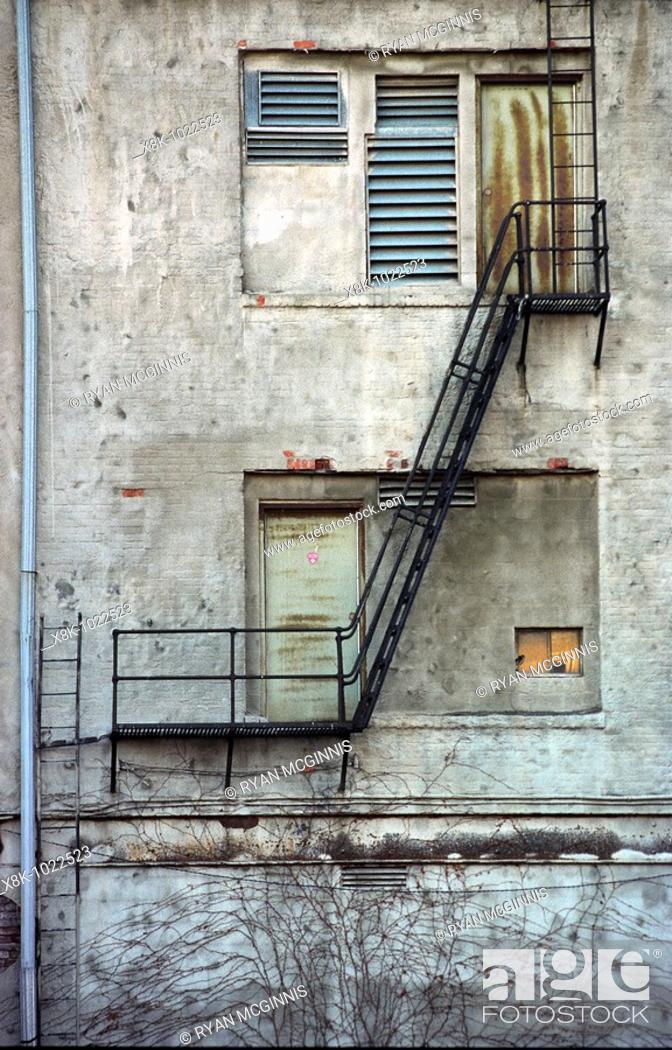 Stock Photo: An old fire escape in an alley in Nebraska.