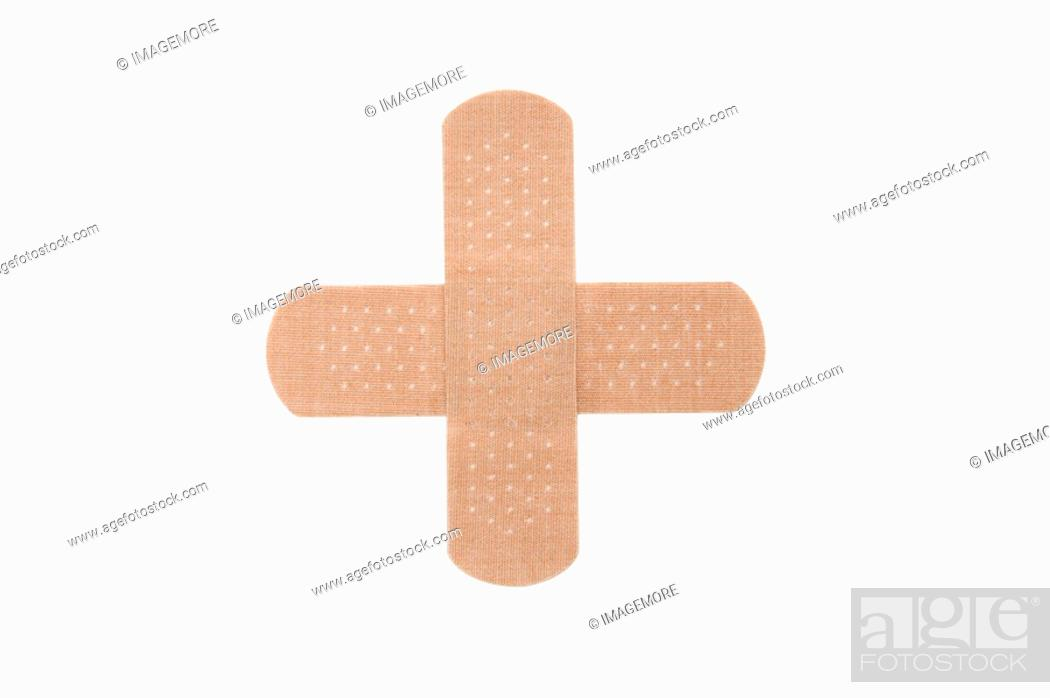 Stock Photo: Adhesive Bandage forming a Cross Shape.