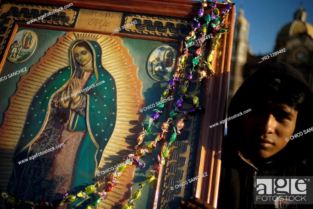 Stock Photo: A pilgrim carries an image of the Our Lady of Guadalupe decorated with candy in Mexico City, December 10, 2010  Hundreds of thousands of Mexican pilgrims.