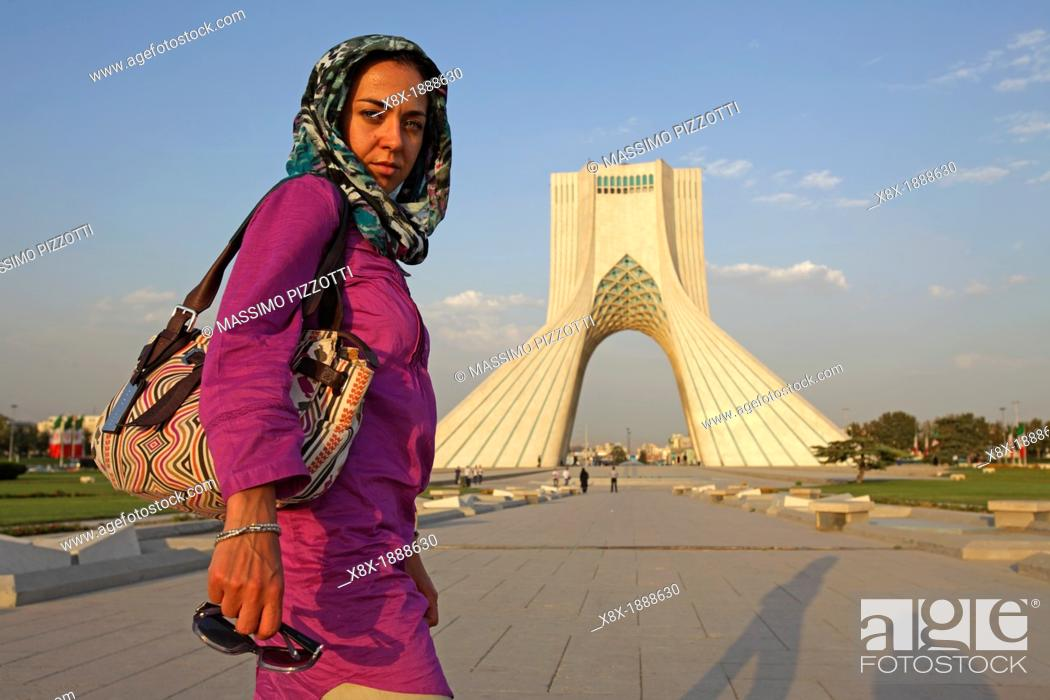Stock Photo: Caucasian woman at Azadi Tower, or King Memorial Tower, Teheran, Iran.