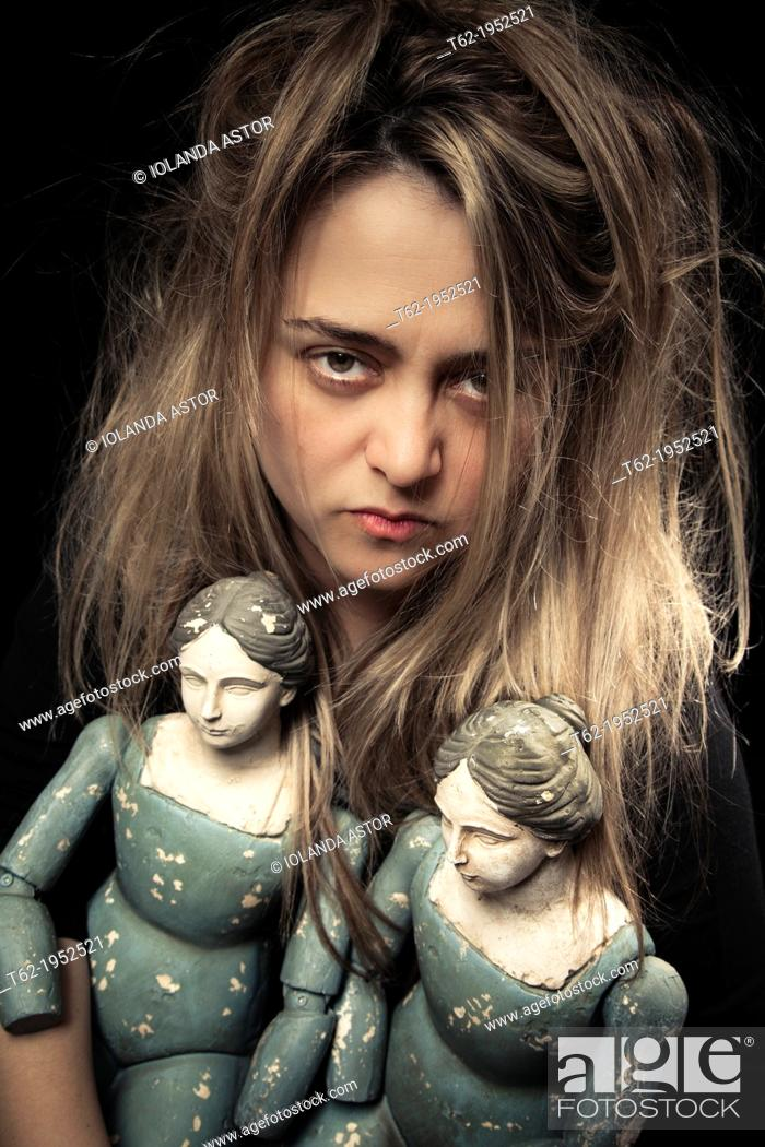 Stock Photo: Madness. Woman and two old dolls.