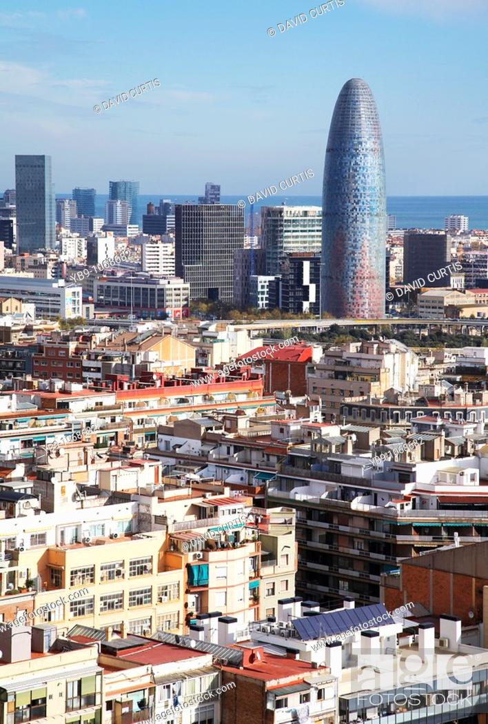 Stock Photo: View of Barcelona city and Torre Agbar tower from Gaudi's La Sagrada Familia temple.