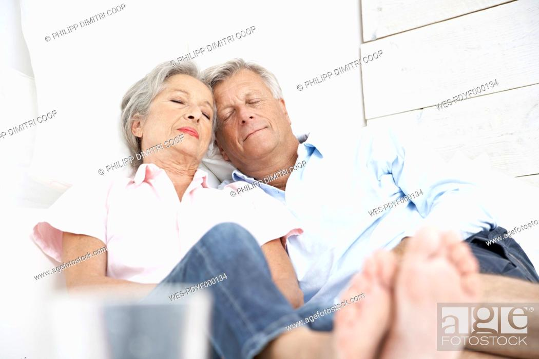 Stock Photo: Spain, Senior couple sleeping on bed in hotel.