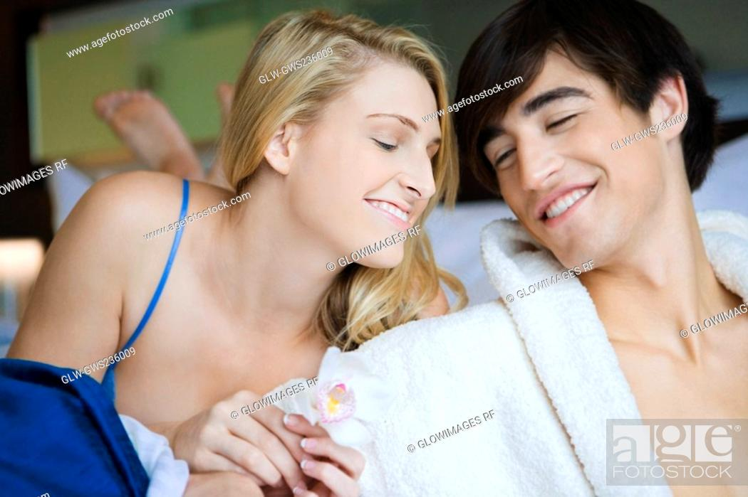 Stock Photo: Close-up of a young couple smiling.