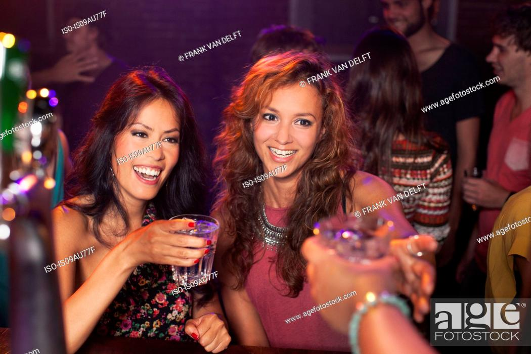 Stock Photo: Women toasting in club.