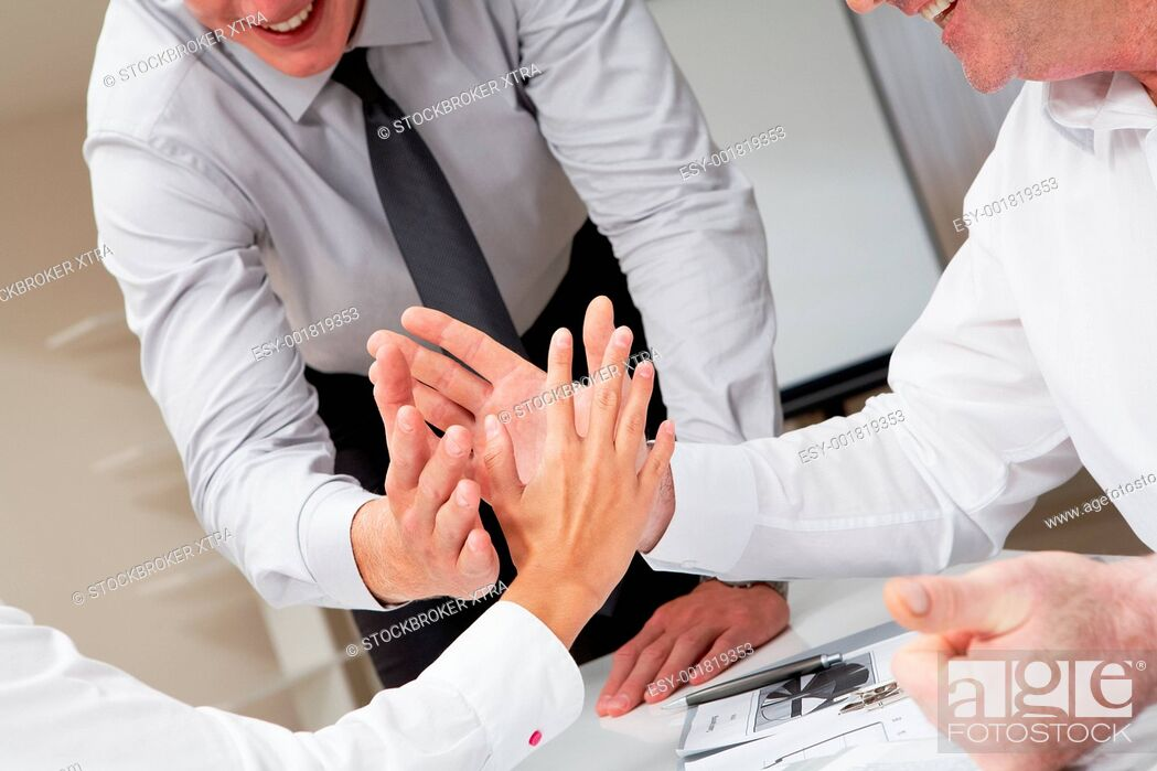 Stock Photo: Close-up of business people palms opposite each other symbolizing support and unity.