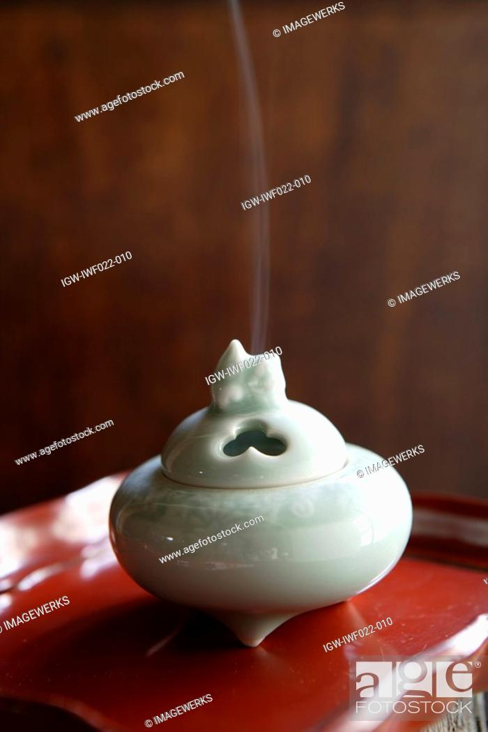 Stock Photo: Close-up of white incense burner.