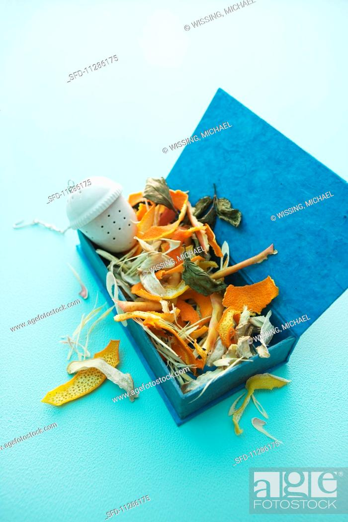 Stock Photo - Homemade fruit tea mix and a tea infuser in a blue box