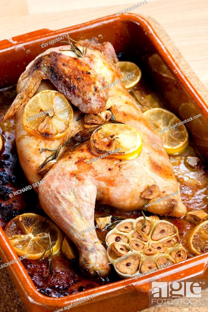 Stock Photo: chicken baked on lemons.