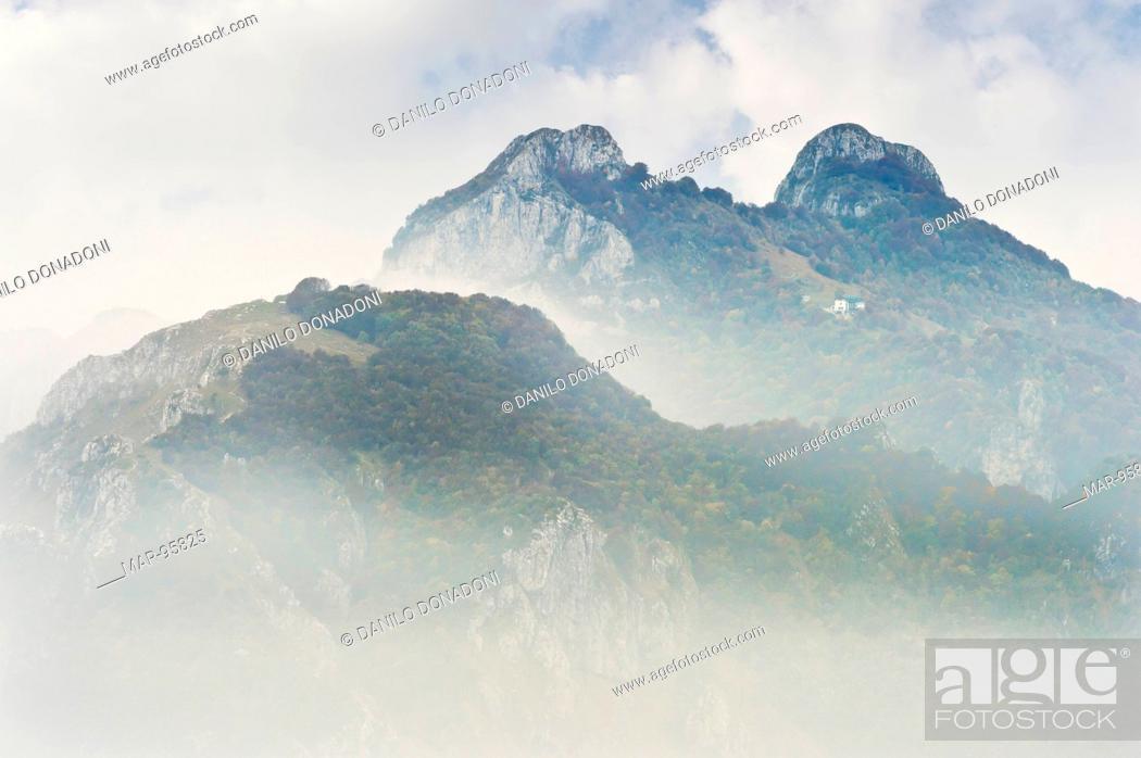 Stock Photo: foggy mountains over the fog, piani resinelli, italy.