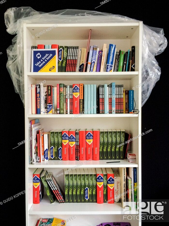 Stock Photo: Tilburg, Netherlands. Bookcase filled with give a way books at Tilburg's Central Station.