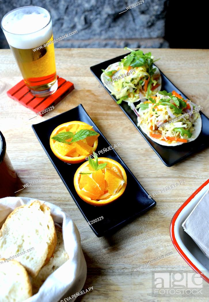 Stock Photo: Mexican tortillas and orange with beer in a restaurant.