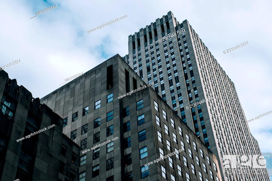 Stock Photo: New York City - USA - DEC 17 2018: Underside panoramic and perspective view to facade fragment of Rockefeller Center building in midtown Manhattan.