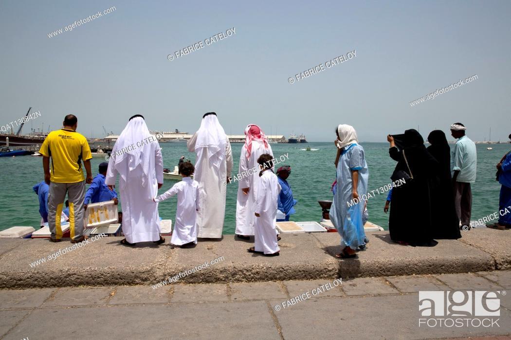 Stock Photo: Qatar - Doha - Fish market on the corniche - Qatari buying fresh fishes.