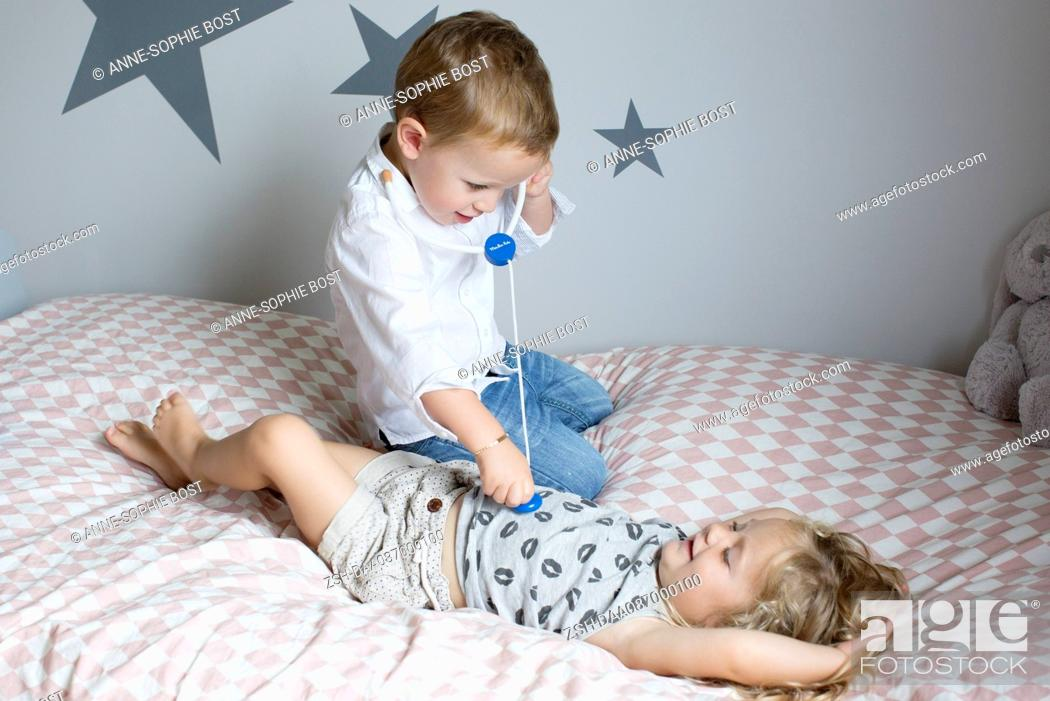 Stock Photo: Children playing doctor with toy stethoscope.